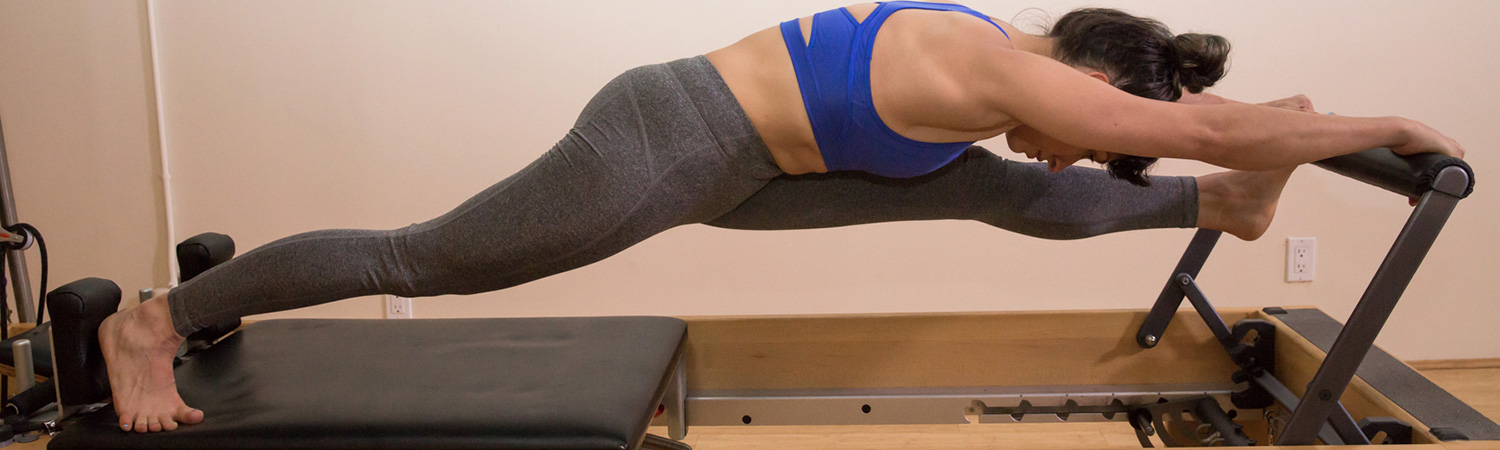woman on a reformer at PilatesWorks