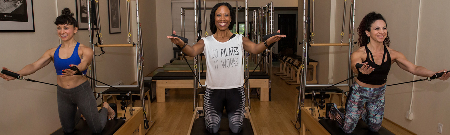 Pilates Instructors demonstrating reformer pilates at PilatesWorks | Reformer Pilates Studio in Long Island City