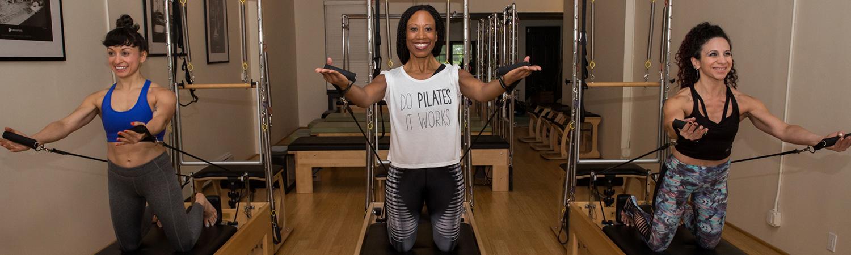 Pilates Instructors demonstrating reformer pilates at PilatesWorks | Reformer Pilates Studio in Long Island City